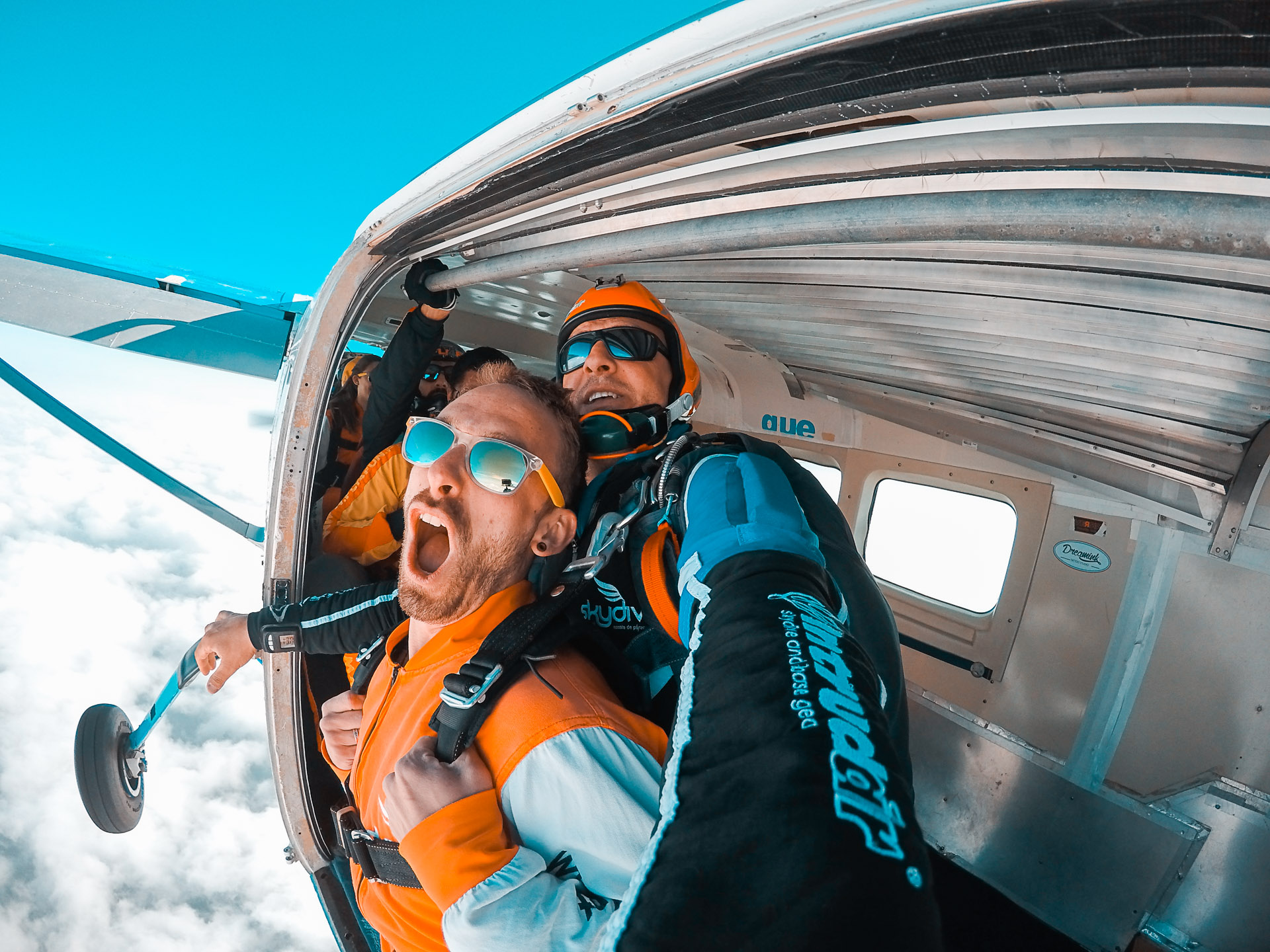 Man jumping out of plane Skydiving_Courage Adventures