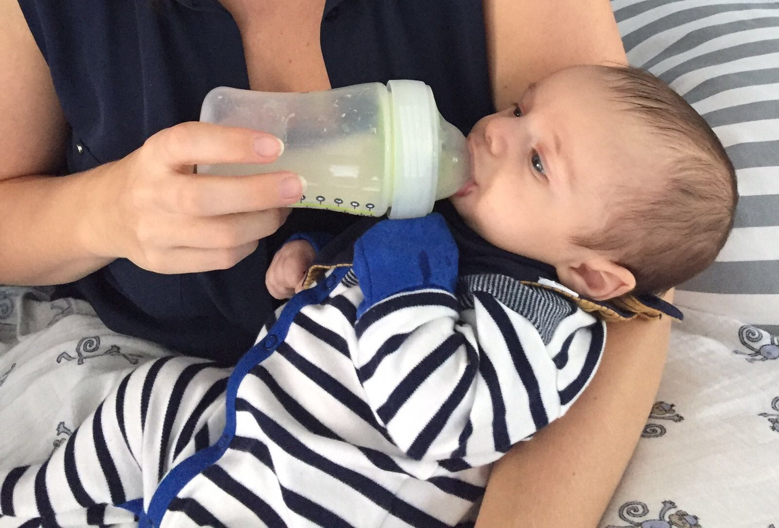 Feeding Leo donor milk using a special bottle meant to work with breastfeeding.