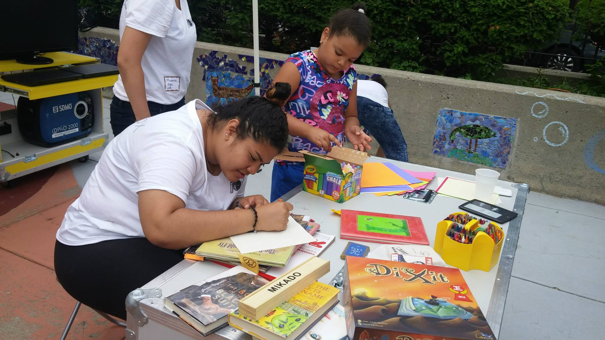 Libraries Without Borders staff doing arts and crafts with youth during an IdeasBox program in the Bronx, New York.