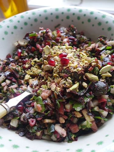 Top with chopped pistachios, the dressing and a few pomegranate seeds. This is one that keeps a few days and the leaves hold up well.