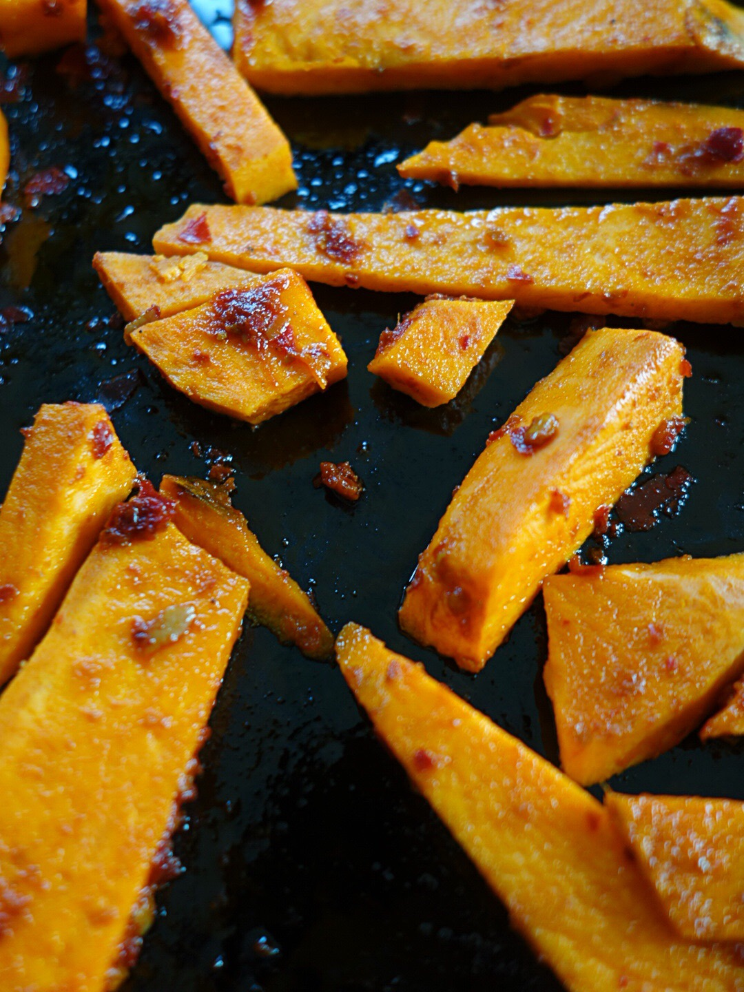 Rub a tbsp of rose harissa paste from  Belazu  plus a small glug of olive oil. Rub thoroughly all over the sweet potatoes and bake for 35 min at 175 c (350 F) flipping a few times.