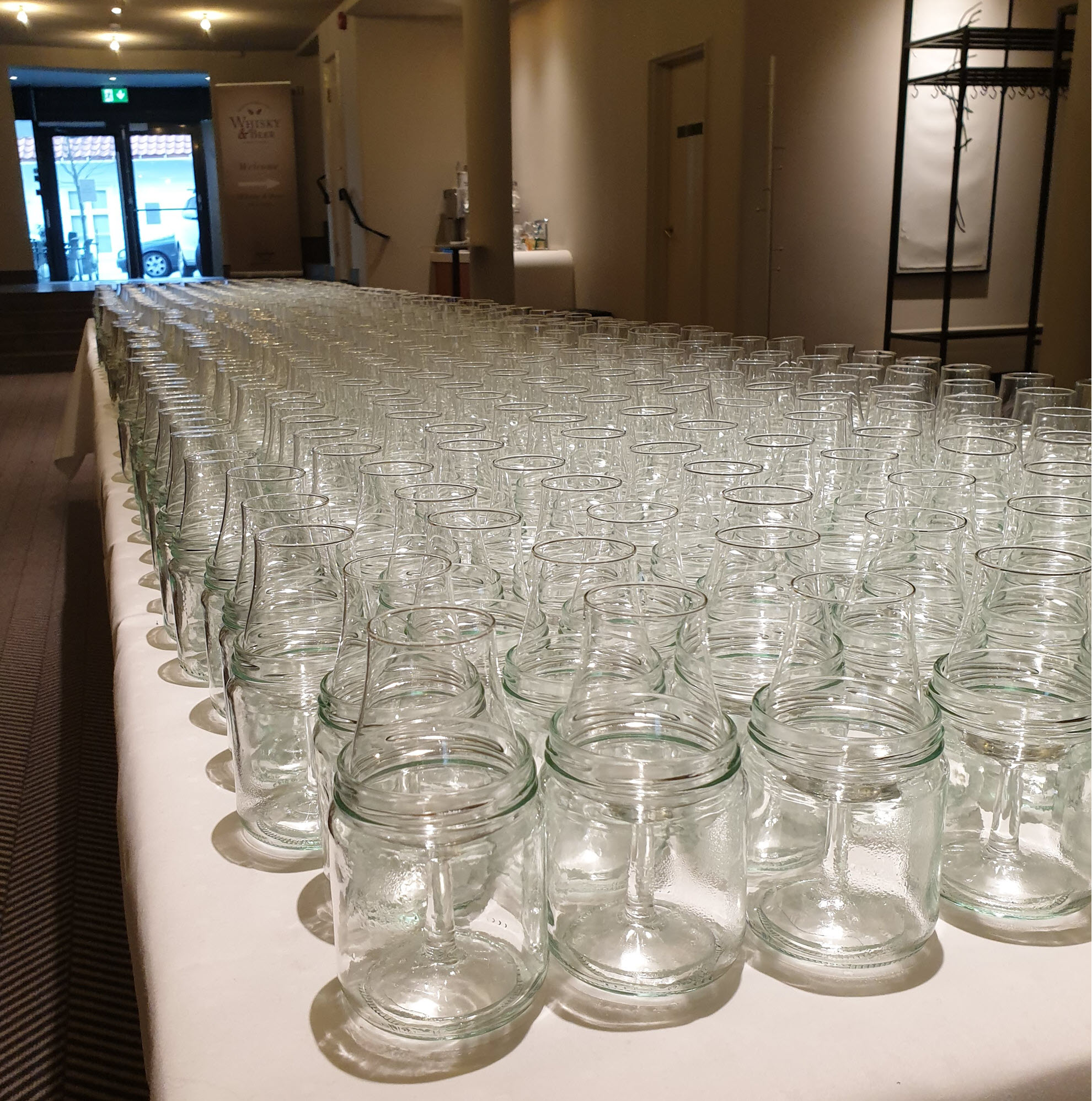 A few glasses lined up. Ticket sales are on par with last year, which means the festival is mostly sold out. All attendees will get a whisky glass and a beer glass when entering.