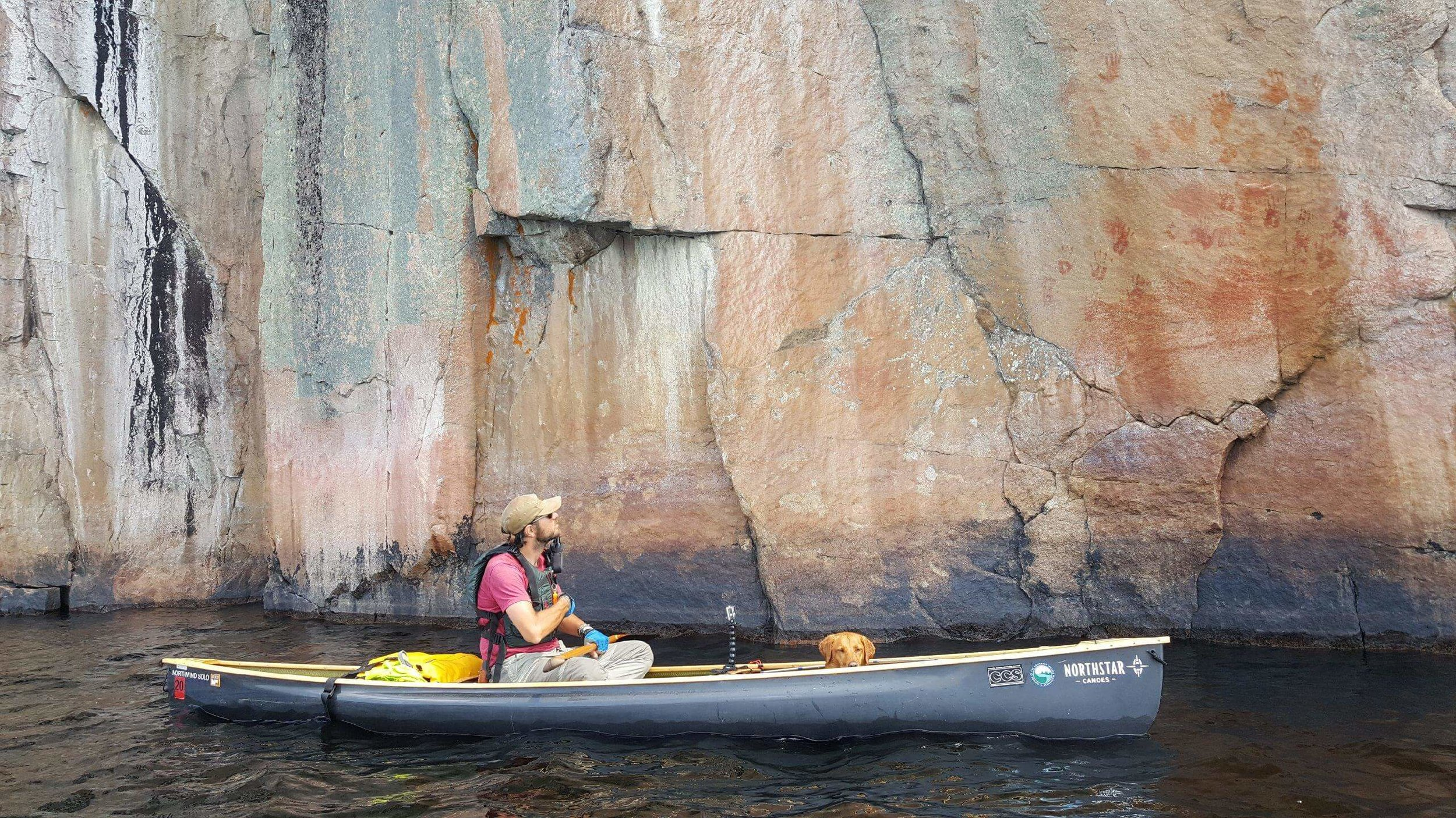Steve Schraeder paddles under the pictographs on Lac La Croix