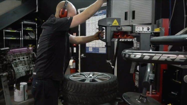 josh using tire machine.jpg
