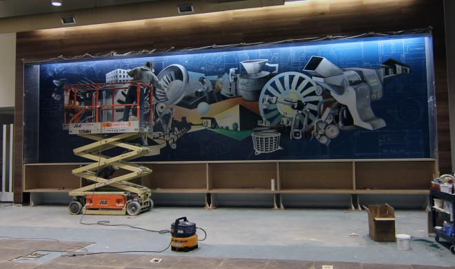 varnishing the mural 2