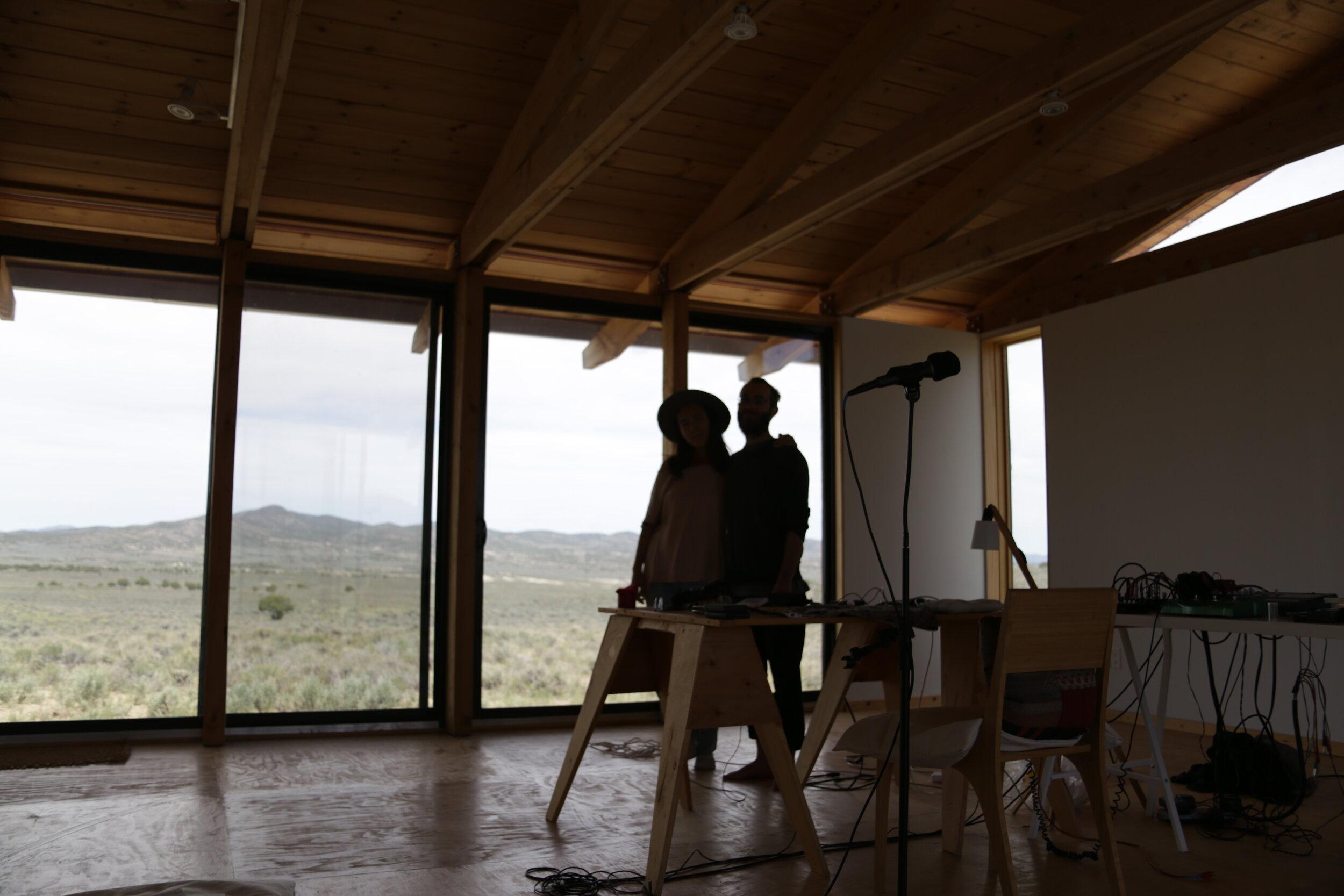 John and Lea in their Montello Residency recording studio, self-timer.