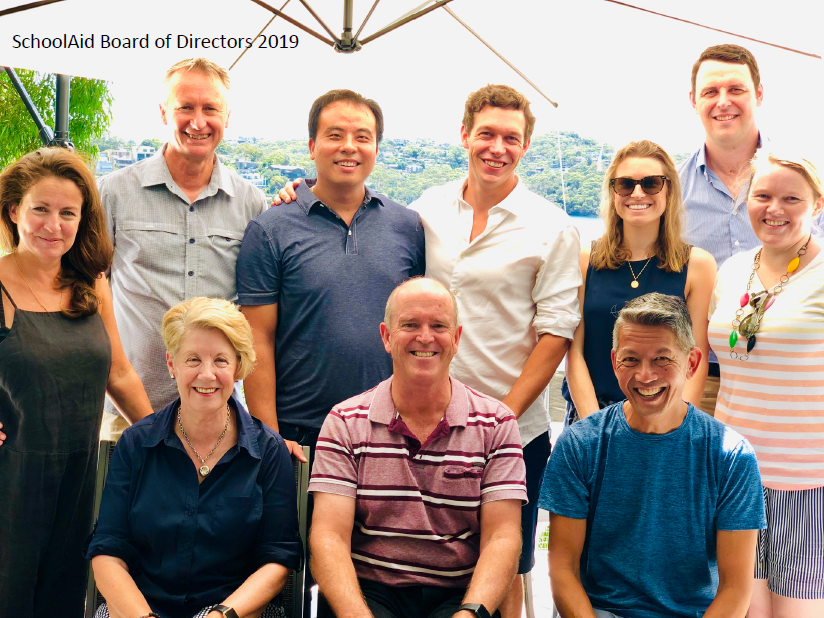 The 2019 SchoolAid Board of Directors in Sydney for the Annual General Meeting, hosted by Chairman Warren Bingham at his home overlooking the harbour.  L to R (back row): Liv Pennie (Chair, Marcomms Committee), Dennis Yarrington (Chair, EYP Committee), Simon Chhoeu (Finance Director & Chair Partnerships Committee), Peter Graf, Stephanie McNamee (The Observership Program), Josh Clements, Julia Phipps (The Observership Program).  L to R (front row): Narelle Barker (KATs Program Director), Sean Gordon OAM (Founder and CEO), Warren Bingham (Chairman).  Absent: Marc Baddams