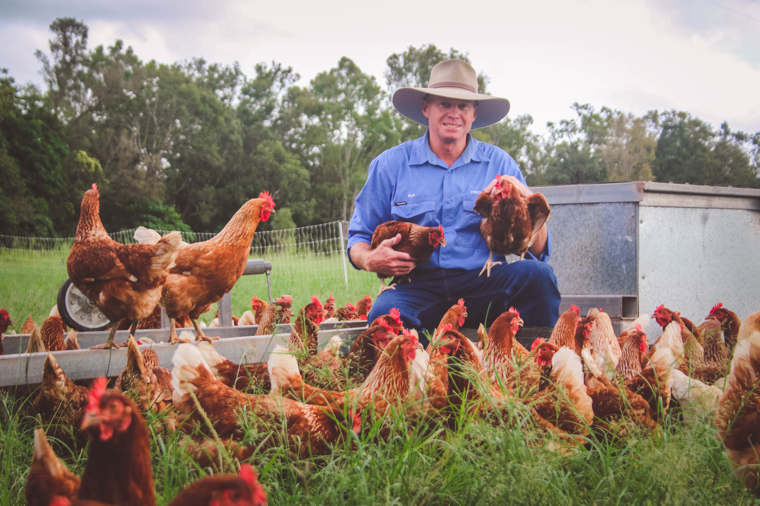 Farmer Rob with his Chickens