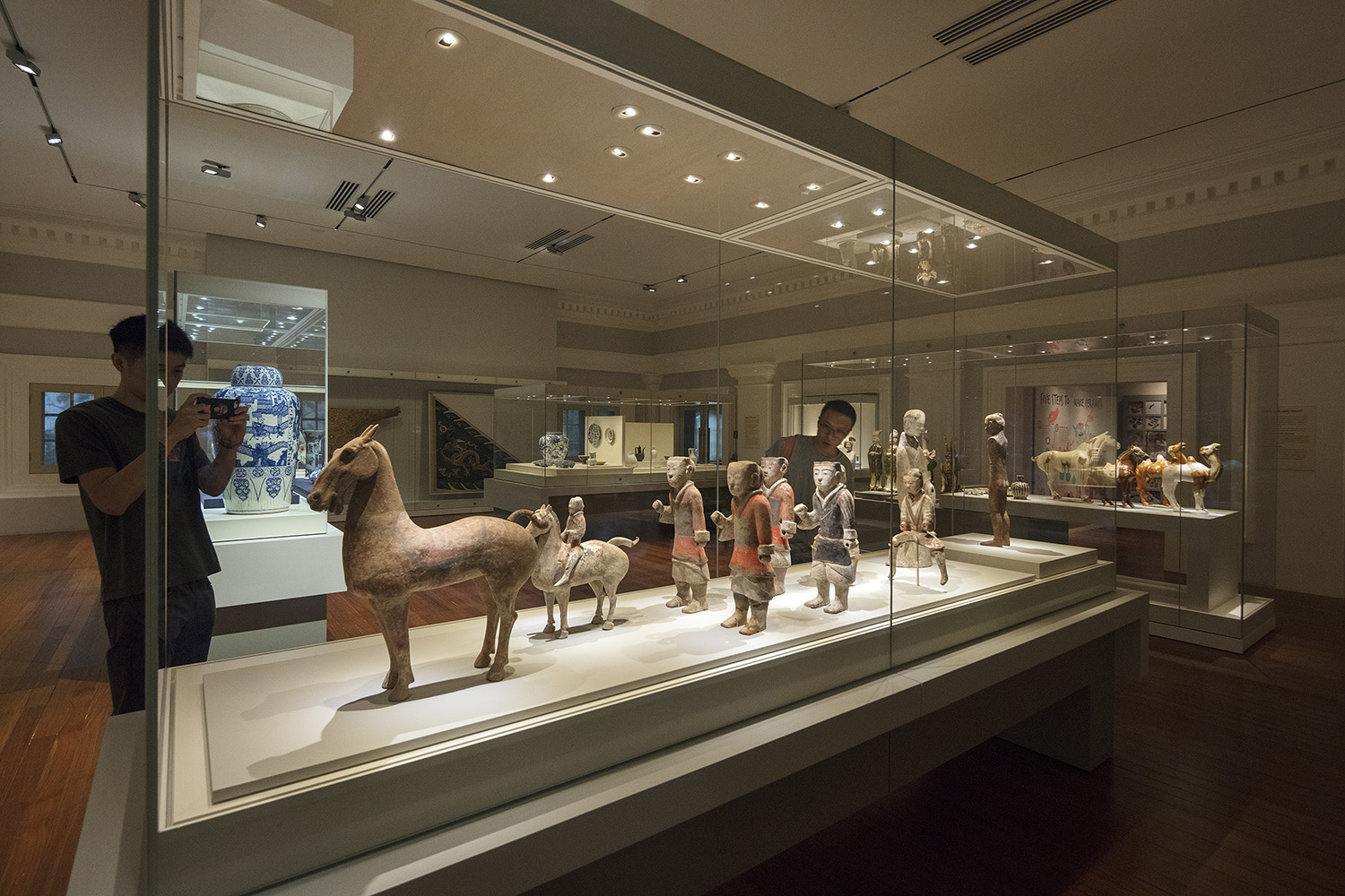 Artefacts are showcased in custom cases and tailored mounts, with spatial planning and directed lighting ensuring they capture the attention of the visitor.