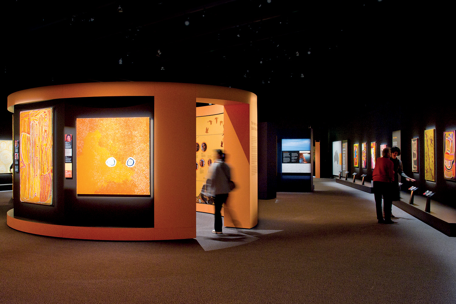 The colours of the Western Desert formed a key component of the design process by providing a sense of geographic context for the visitor, enhancing the visual offering of works on display, and distinguishing sections of the exhibition while maintaining a thematic consistency throughout.