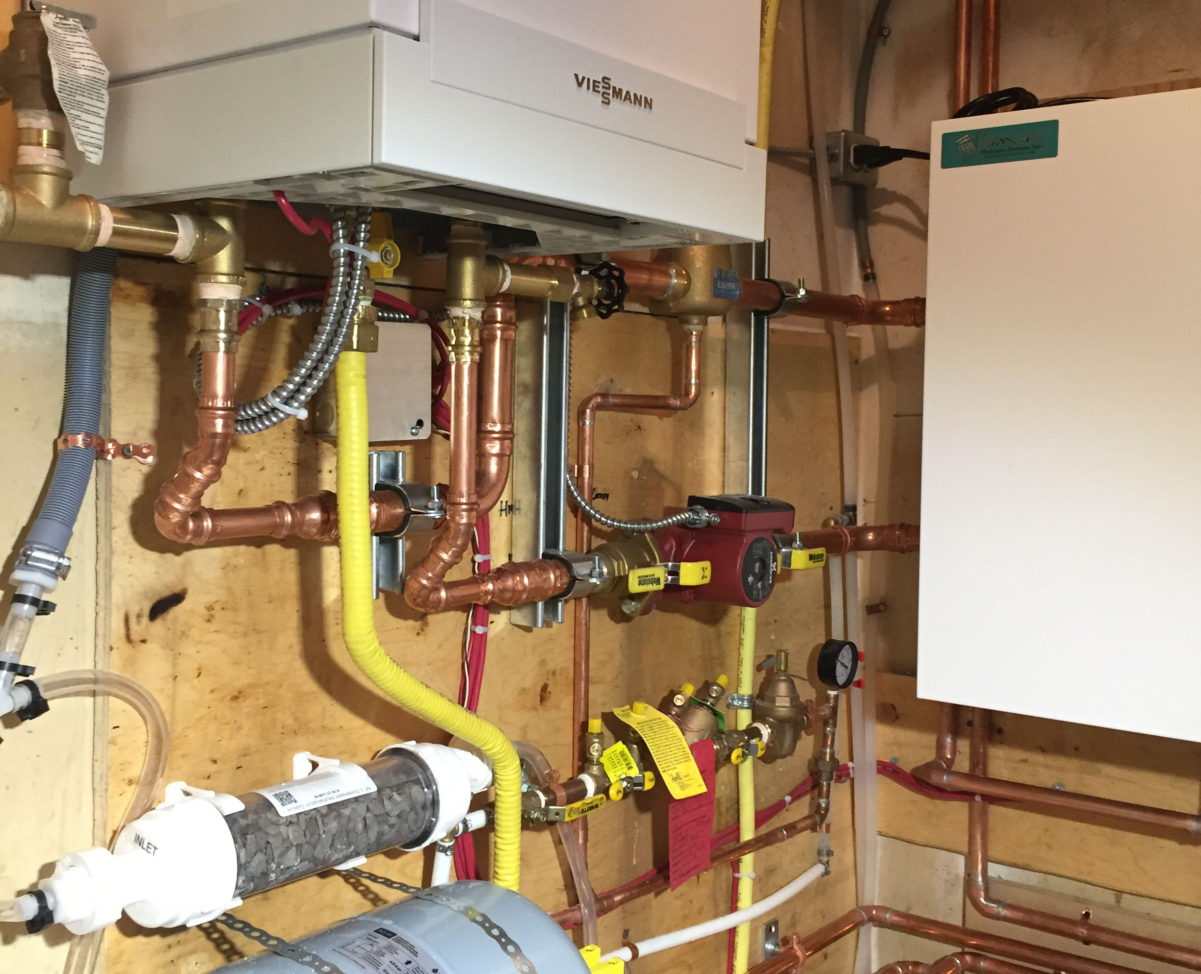 HYDRONIC HEATING - We service, repair and install tankless hot water systems.  Our technicians will service your system to ensure optimal operation.