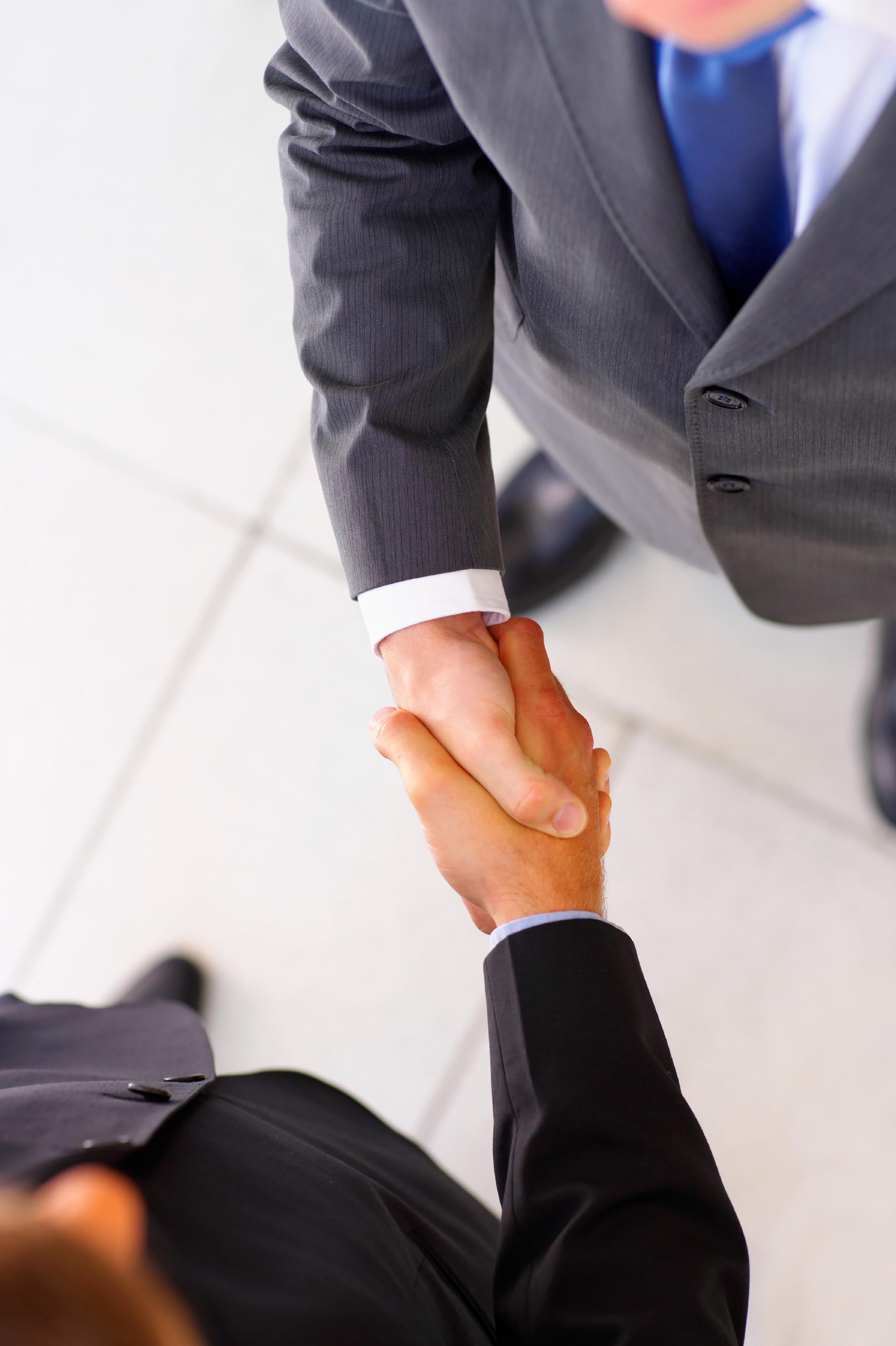 Australian businessmen shaking hands