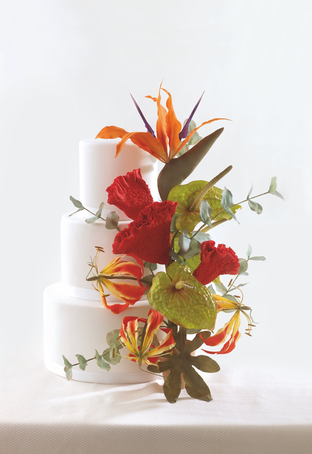 Exotic arrangment with cake From The Kew Book of Sugar Flowers.jpg