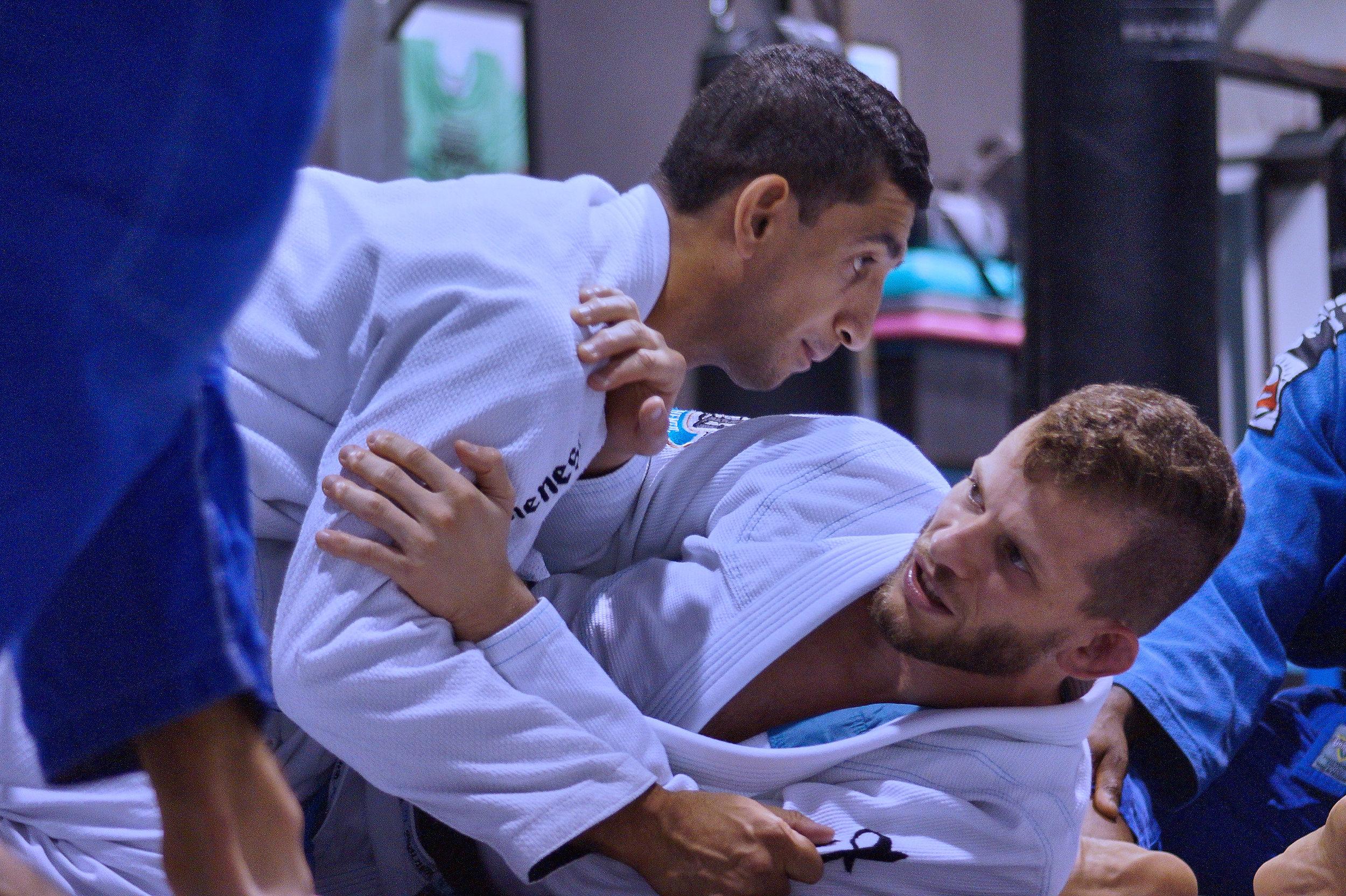 Milton Bastos, multiple time WORLD BJJ CHAMPION, showing Greubel's MMA students some finer points Brazilian Jiu-jitsu. Milton (bottom) pictured with Ares BJJ black belt Ale Nogueira (top).