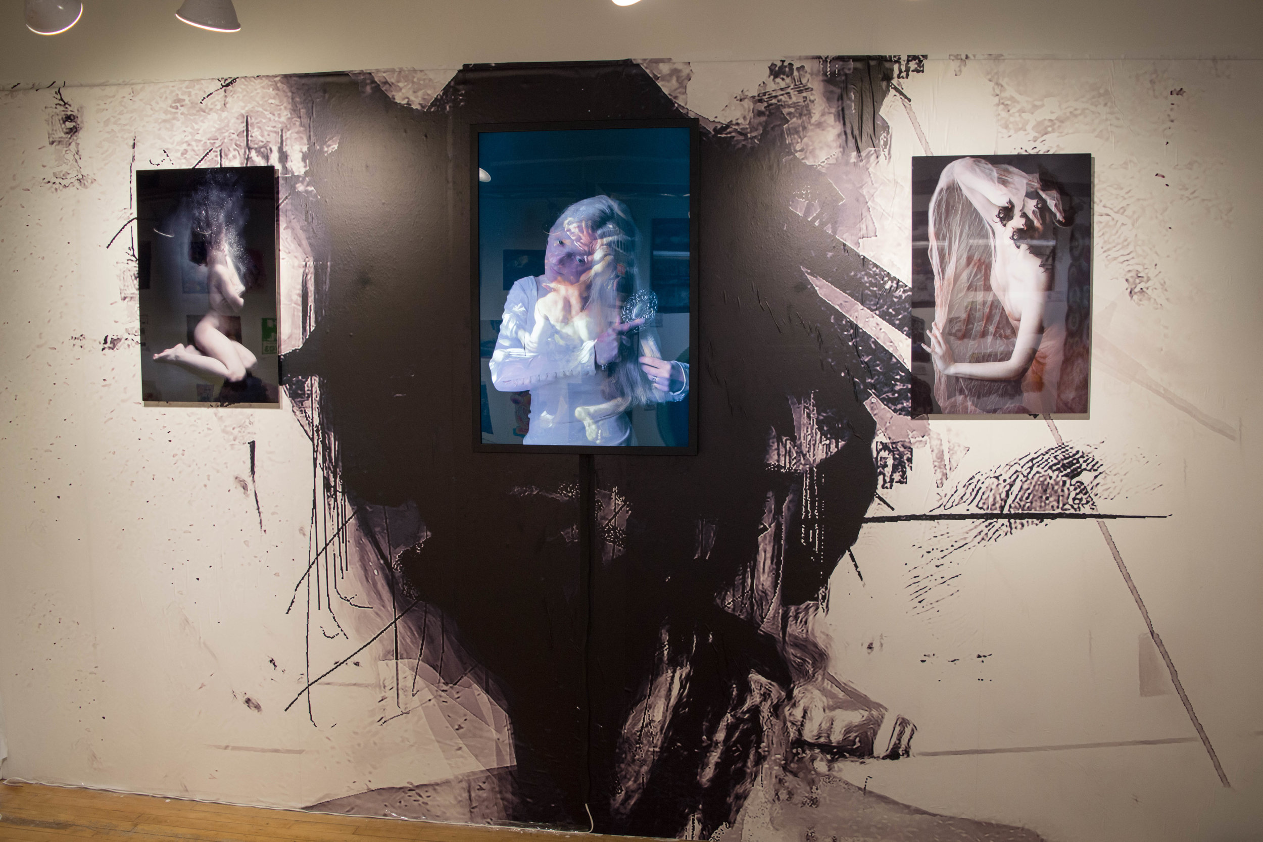 """From left to right: """"Ashes"""" Limited Edition Aluminium Print, """"The Weight of Silence"""" Lightbox and """"The Faceless Maiden"""" Limited Edition Aluminium Print. (Backdrop, """"Relapse"""")"""