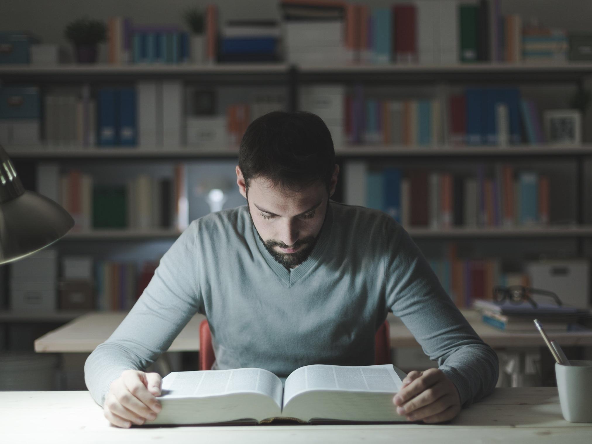 smart-man-studying-at-night-P3DMWXV.jpg