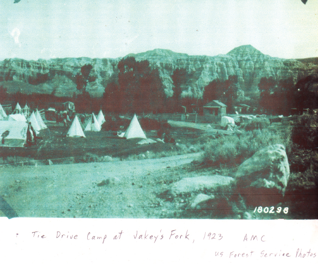 A temporary Tie Drive camp for lumberjacks moving railroad tie down the Wind River. 1923