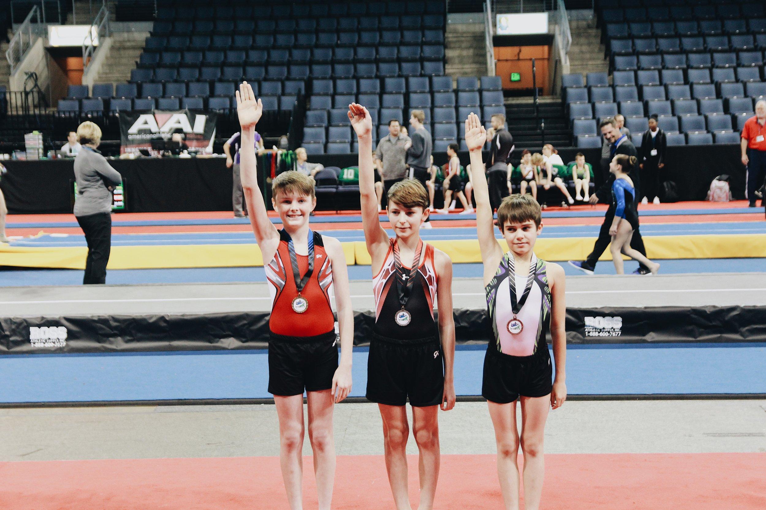 Garrett, far left, saluting with his first place flight award.