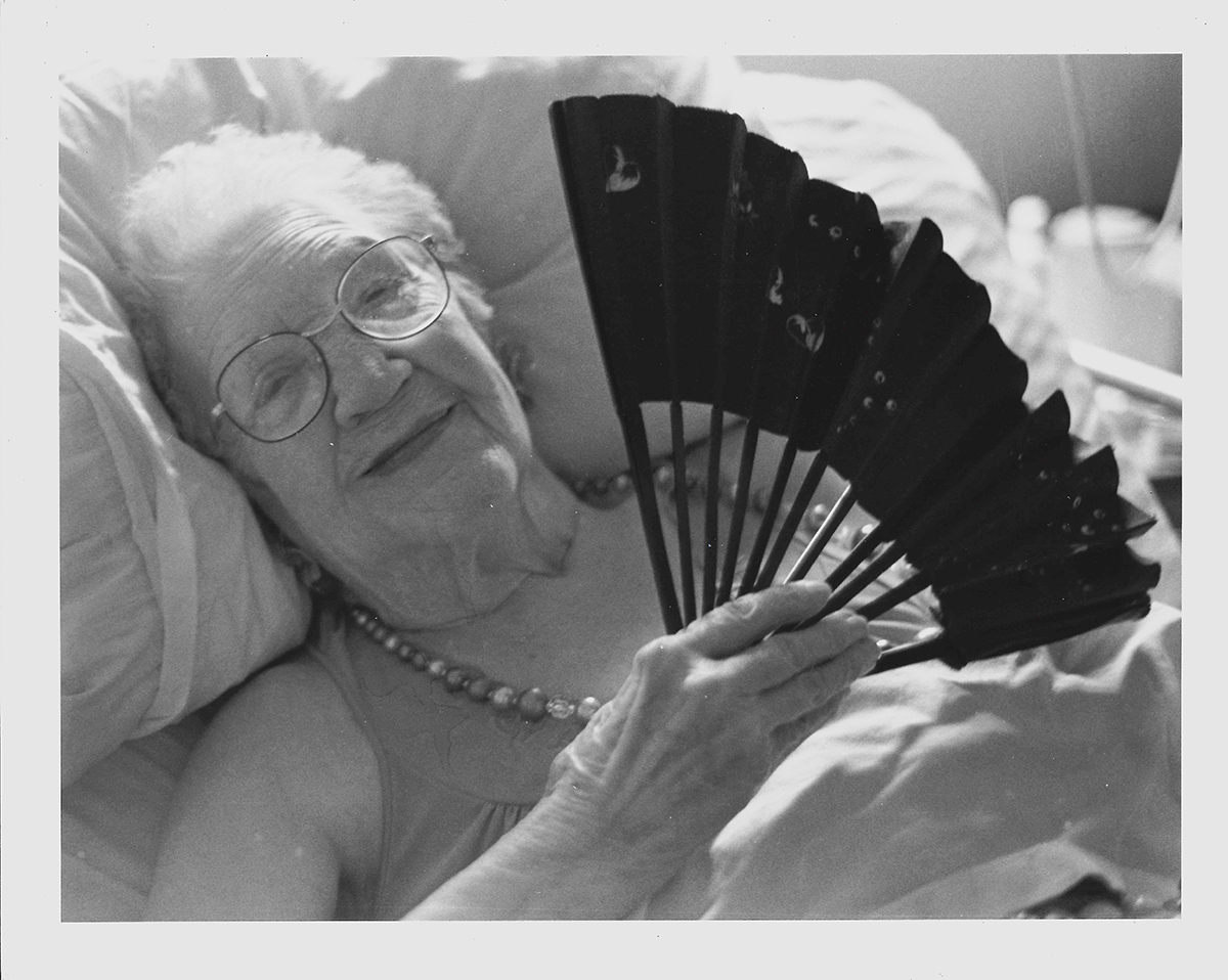 My Grandma Ruth in her nursing home bed, photographed with a 35mm film camera and developed in my college darkroom.