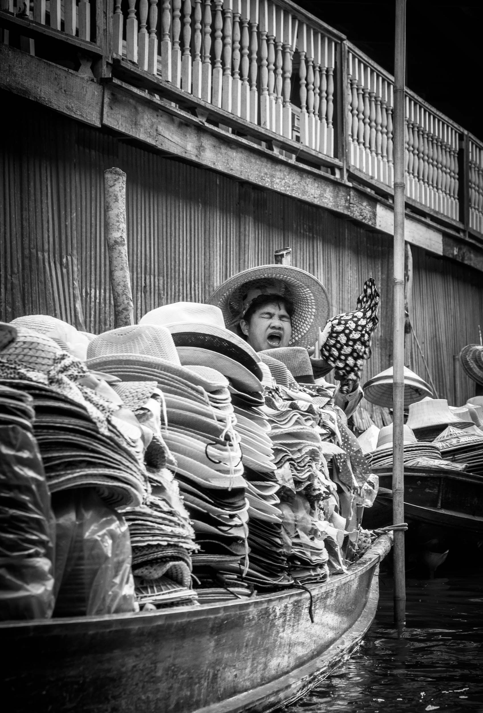 Selling Hats in Ratchaburi, Thailand.