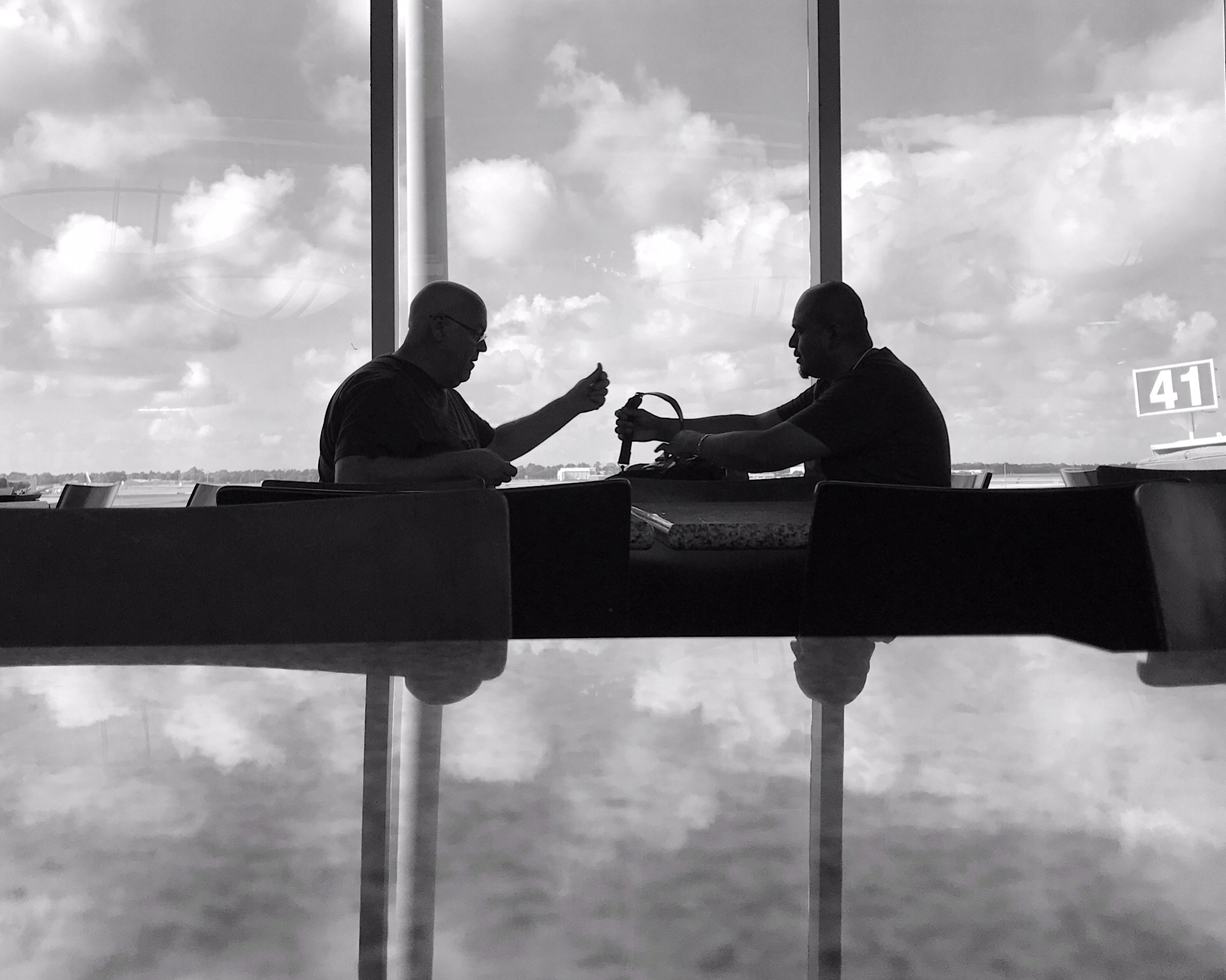 Men reflection Houston Hobby.JPG