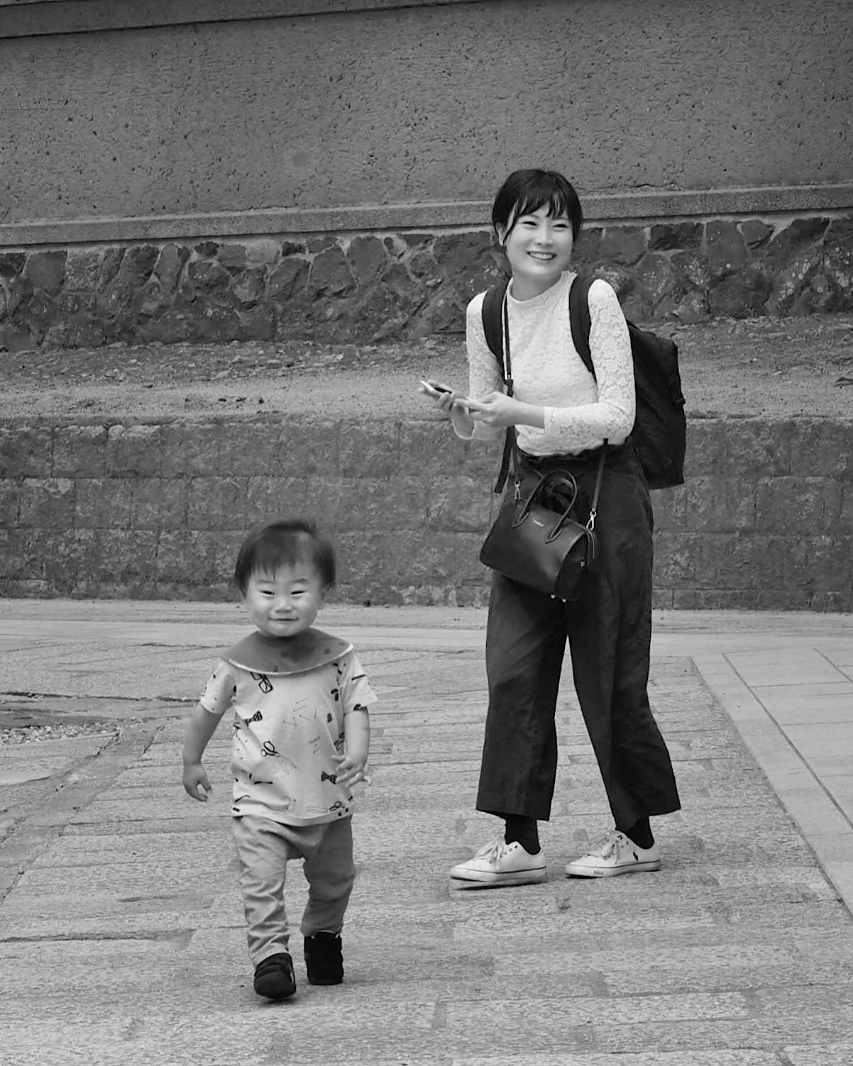 This child's face has soft focus. I do not think it was the shutter speed since that was 1/640 sec., which is usually sufficient, especially for someone walking toward you. The aperture was f/6.3. I think I focused on the woman's face and there was not enough depth of field for the child's face, because he was a good bit in front of her. I wish I had focused on the child, then most likely the woman would be in focus. You will get significantly more depth of field behind the focus point than in front of the focus point. In the big scheme of things, it does not matter. This picture is one that I like and it has been well received by viewers.