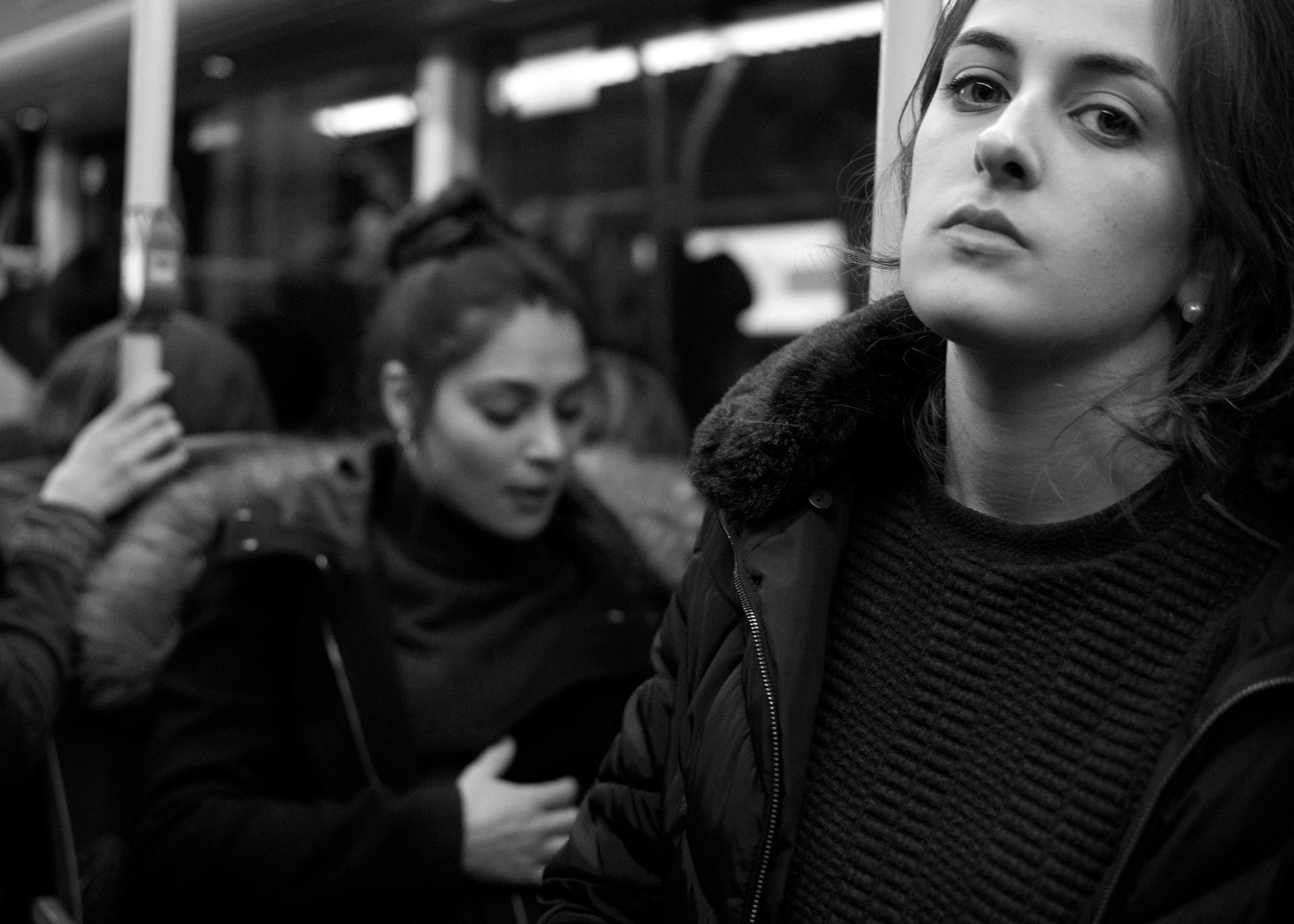 On the Subway in B&W. Photo by @the_human_journey_ Used with permission. Click picture for a larger image.