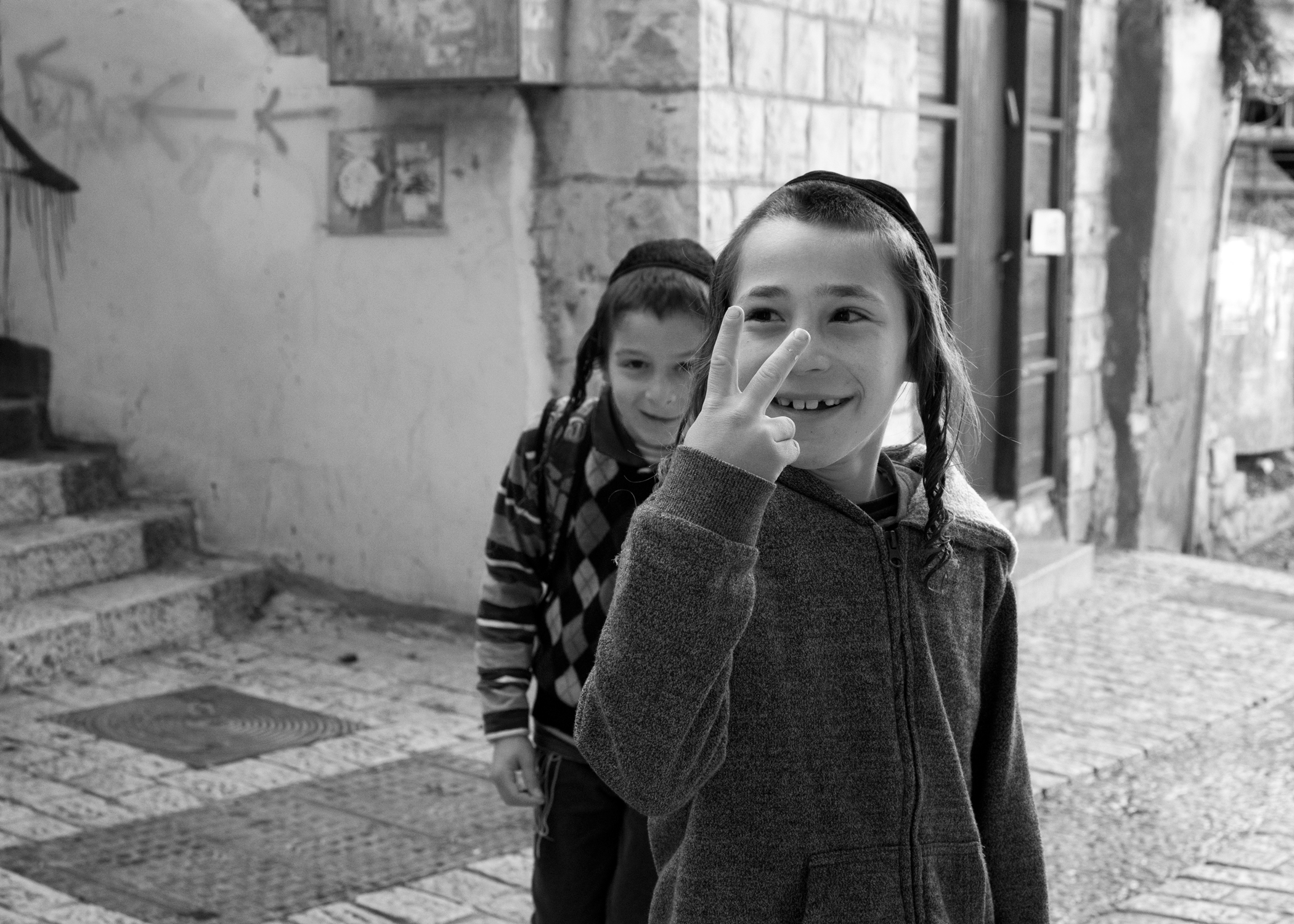 Little Boys and Peace or Victory in B&W. Photo by @the_human_journey_ Used with permission. Click picture for a larger image.