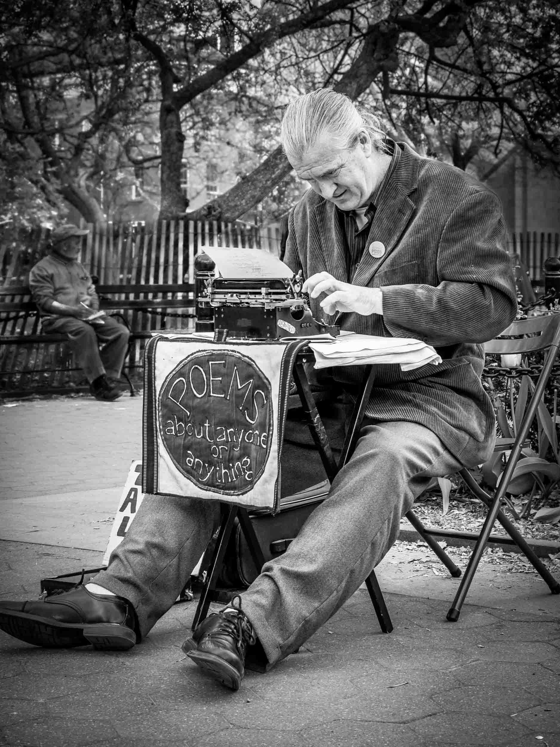 This is a nice memory picture that I took in Washington Square in NYC, but this poem-writing street performer is probably one of the most photographed persons in the United States. Click picture for a larger image.