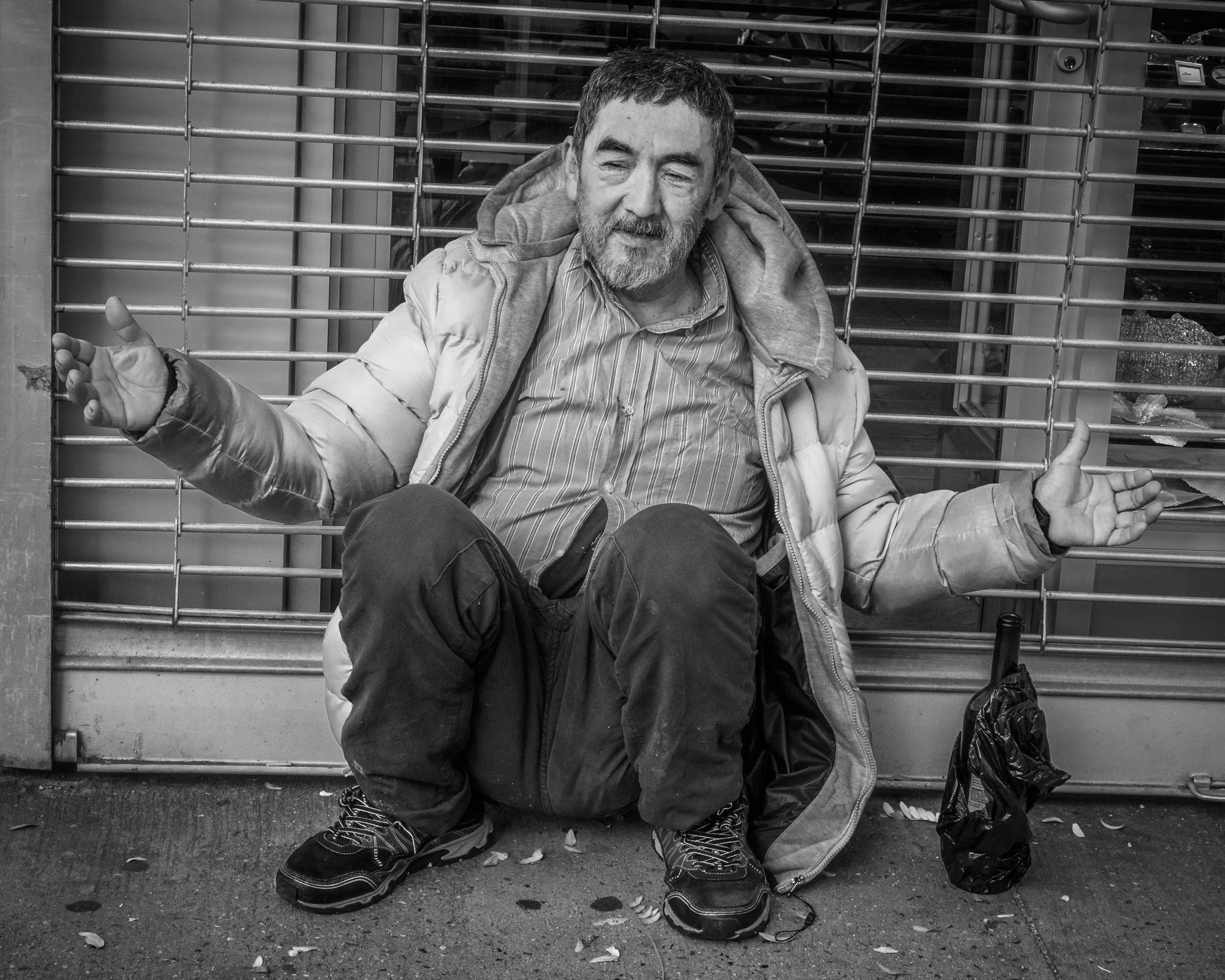 I do not typically take pictures of a homeless person, but this one was taken because he asked me to take it. He definitely was posing.
