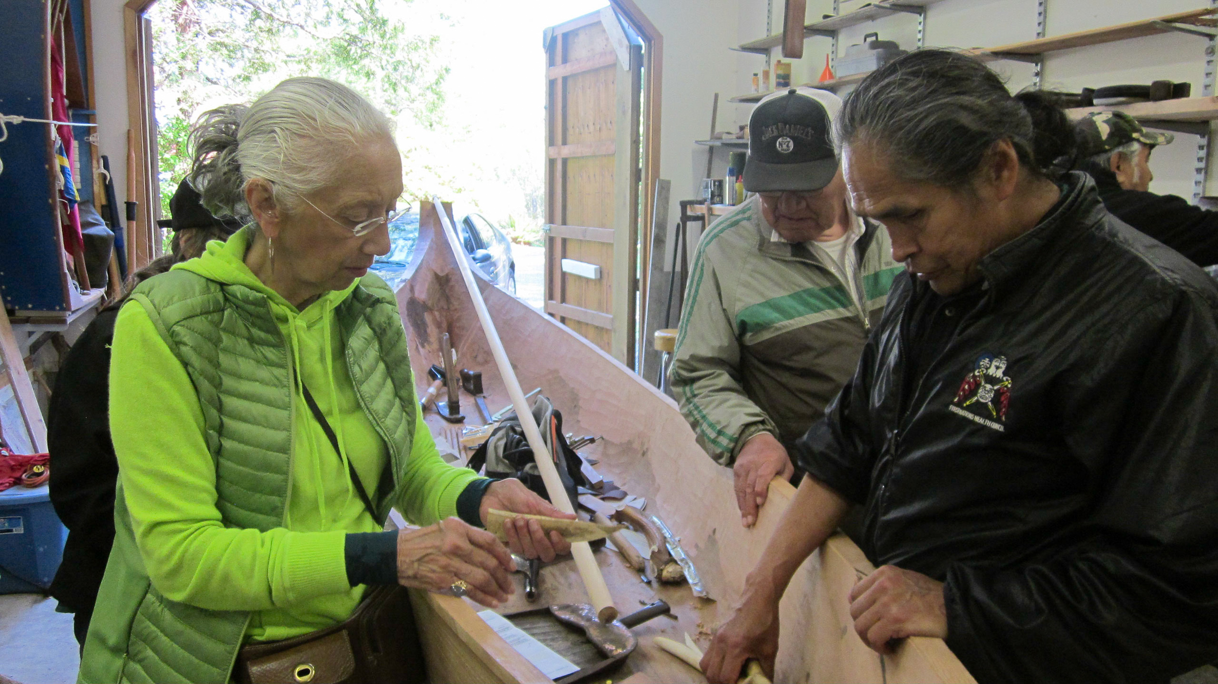 Academy Founding Director, Rose Thater Braan-Imai (Tuscarora) with Master canoe builder Joe Martin (Nuu-chah-nulth) at his carving shed in Tofino, British Columbia.