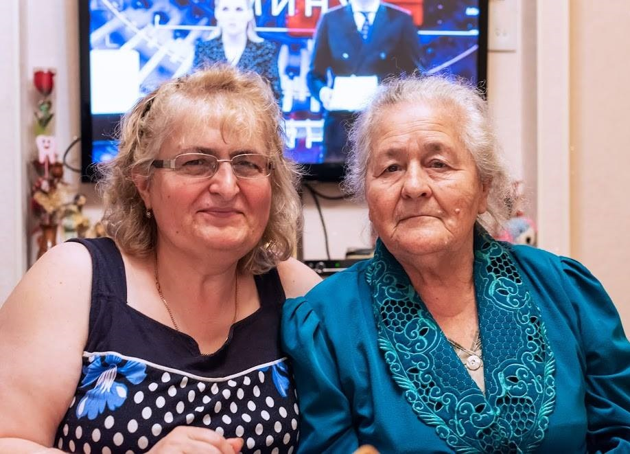 Karine (left) and her mother (right) pictured in their home.     Photo credit to Kristin Anahit Cass