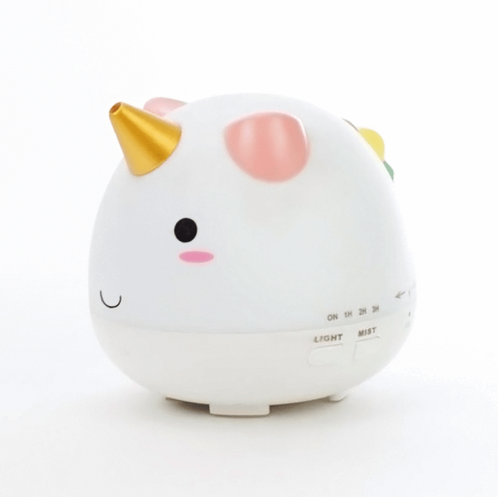 UNICORN MAGIC DIFFUSER - Add a little magic to your essential oil diffusing with the Unicorn Magic Diffuser! This adorable water-based ultrasonic diffuser is perfect for children and the young at heart. The Unicorn Magic Diffuser diffuses a steady long-lasting mist for 6-8 hours. For shorter mist times, the unit also includes a convenient auto shut-off timer for 60, 90, and 180 minutes and features a multi-colored LED light to customize your aromatic experience.$60.00 Retail | so stinkin cute