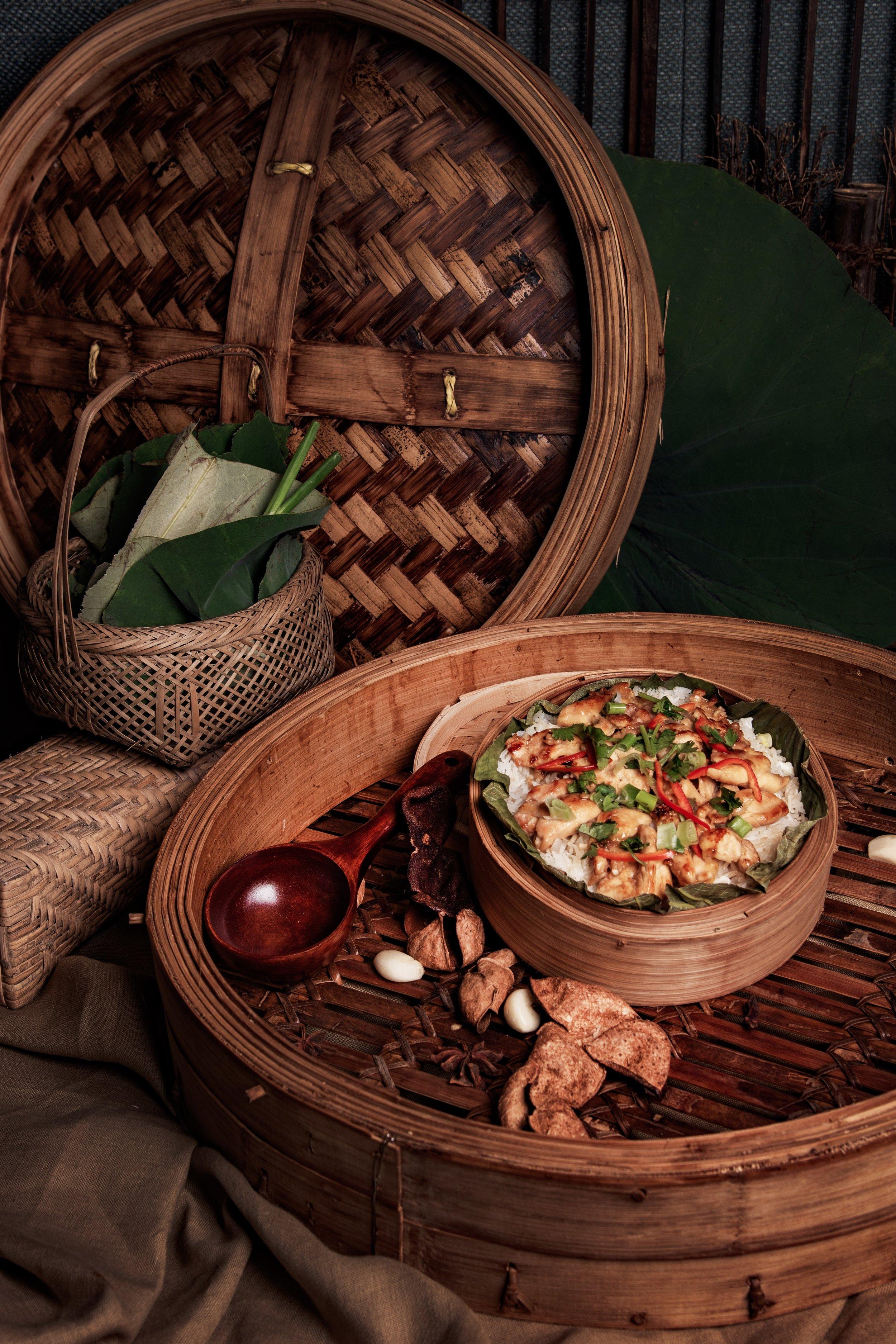 Steamed Rice with Pan-fried Chicken and Mandarin Peel serving on Lotus Leaf.jpg