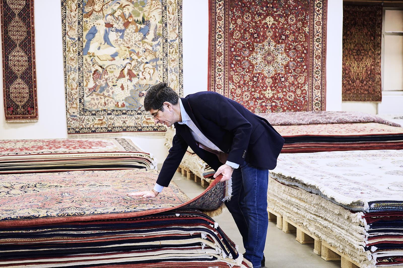 Dr. Ali Ipektchi in the hamburg based persian rug warehouse