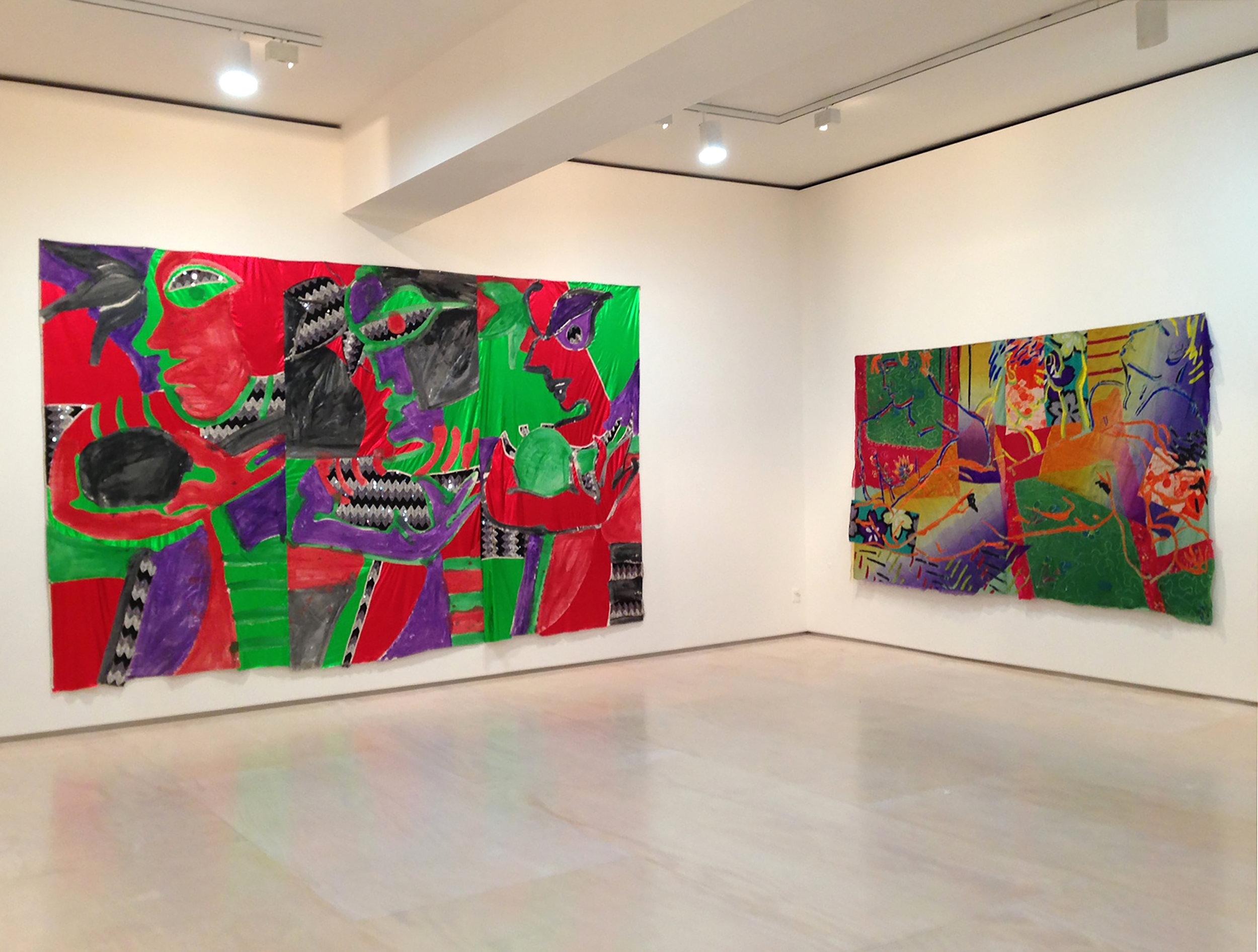 Installation view: (left) Robert Kushner,  Samba Class , 1982, acrylic on cotton with sequin and mylar reverse appliqué; (right) Robert Kushner,  Torrid Dreams , 1984, acrylic, silk and cotton appliqué on cotton.