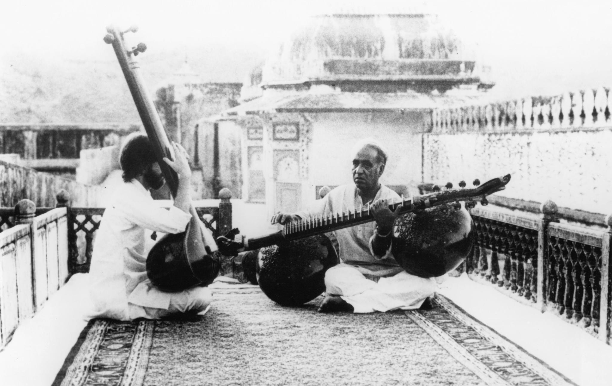 Ustad Zia Mohiuddin Dagar teaching a western student (from Dhrupad film by Mani Kaul 1982)