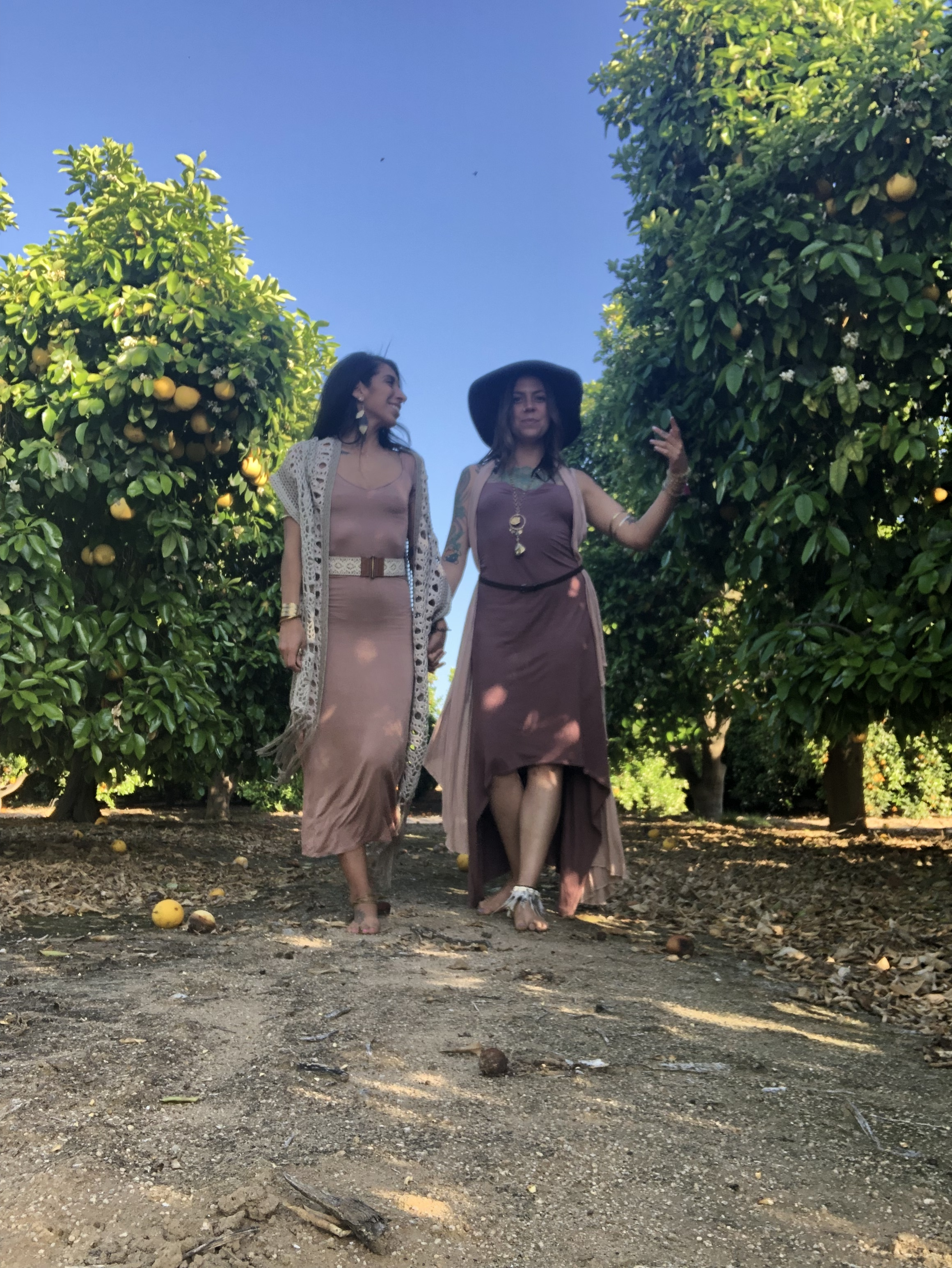 Two Priestesses walking in the cove of Orange Blossoms after an incredible soundhealing cacao ceremony. Life is better in Love.