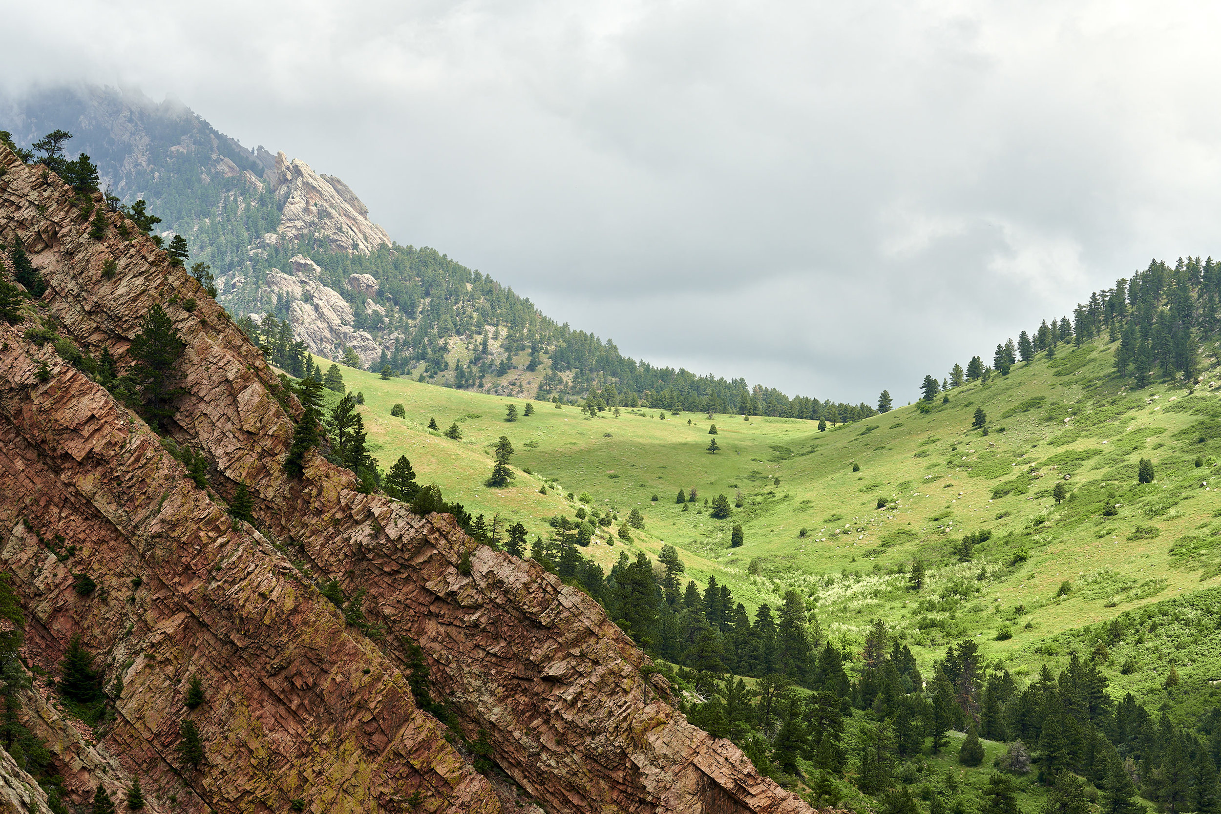 A view of Eldorado Canyon State Park from Fowler Trail. The red rocks in the left foreground are very popular among rock-climbers