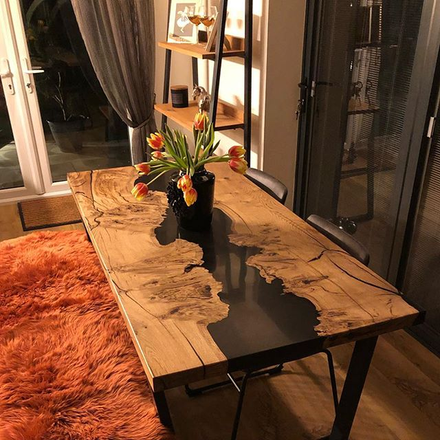 Resin river dining table looking fabulous in its new home  #rivertable #blackresin #resintable #granddesigns #diningtable #contemporaryliving #oaktable #homedecor #Woodfurniture #resin #handmade #MadeinEngland