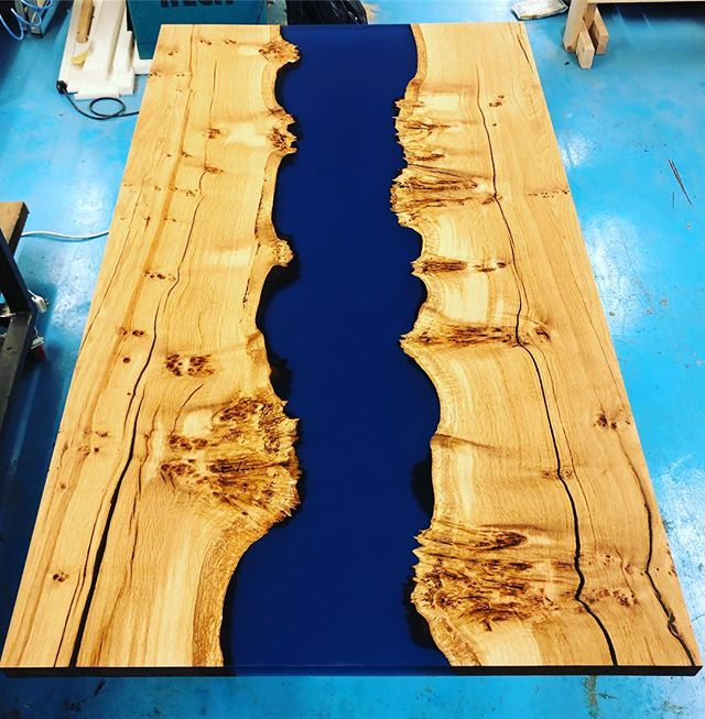 BURR OAK RIVER DINING TABLE // The translucent blue resin river brings out the beautiful textured features of the wood - and it will be needing a home very soon.  #resinart #rivertable #resin #furniture #handmade #interiordesign #designinspo  #diningtable #dinningroom #oak #blue #resin #featuretable #woodworking