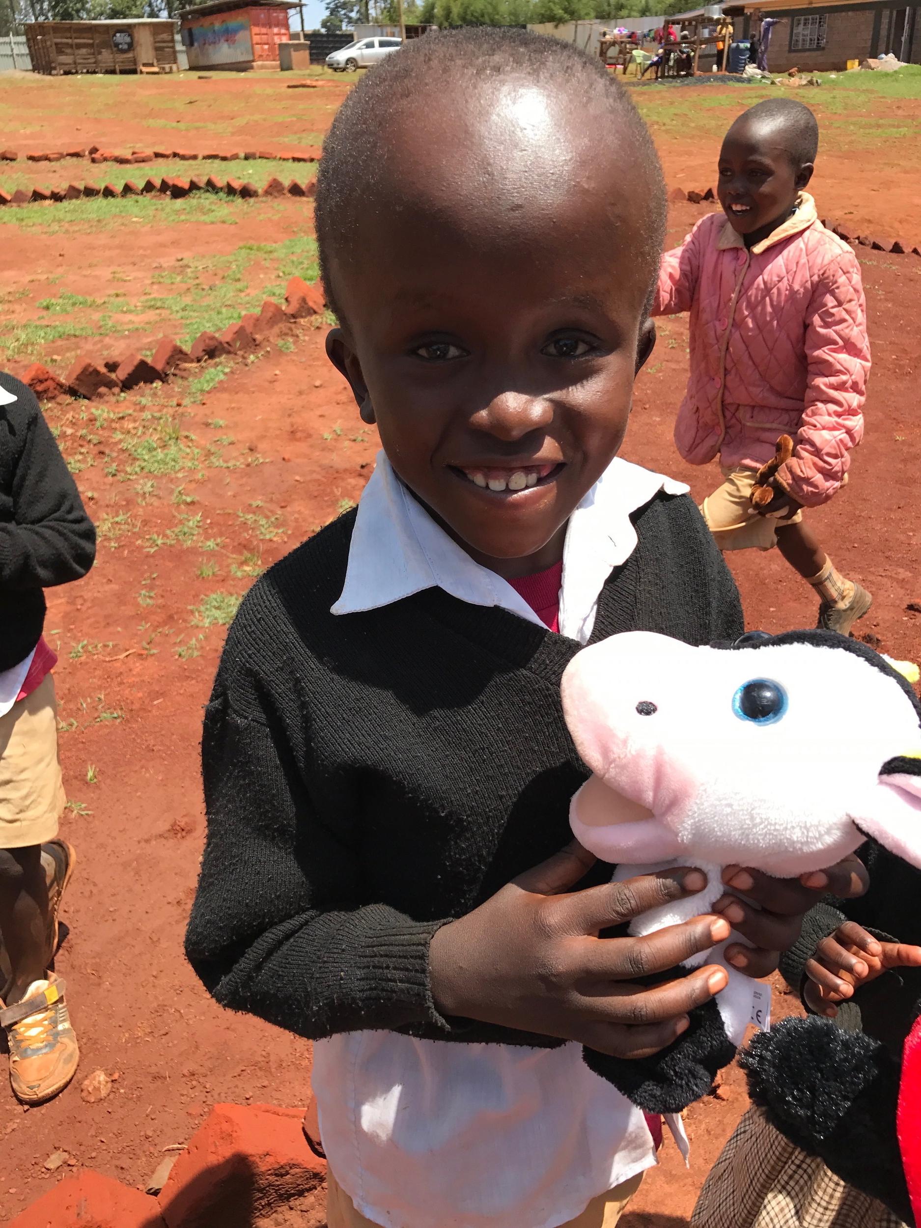 SheHopes.org Precious Kids Boy and Cow.JPG