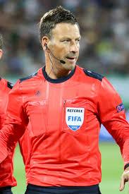 Mark Clattenburg started refereeing in 1990.