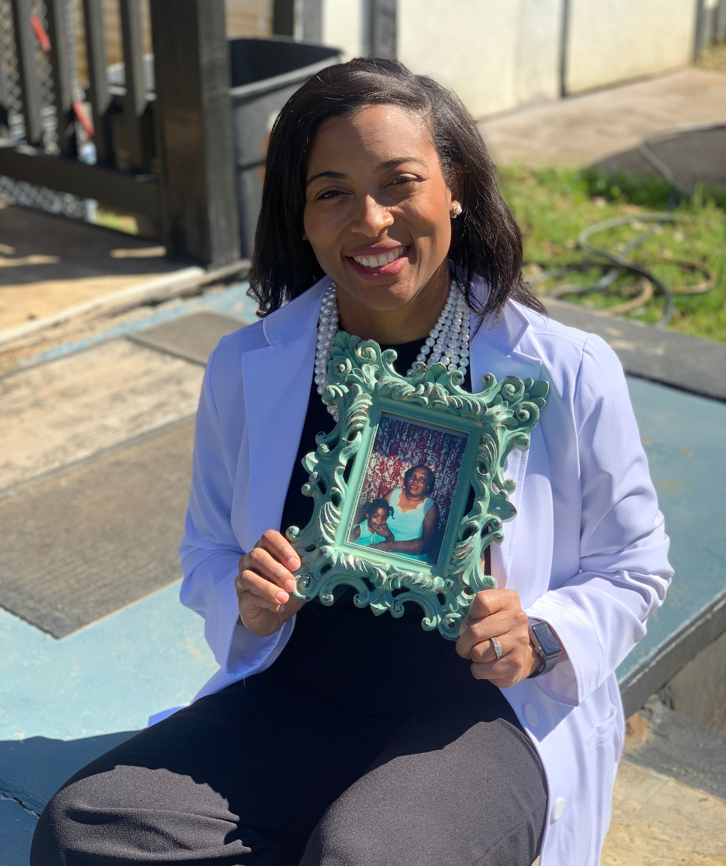 Dr. G holds a picture of her with her grandma, one of the biggest positive influences in her life.