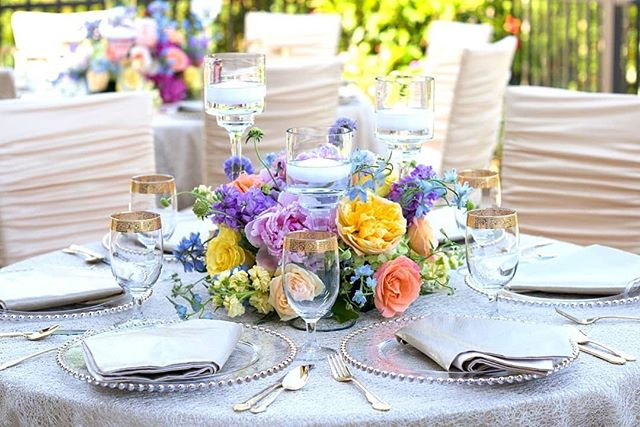 A beautifully designed table setting with a soft-hued flower centerpiece paired with elegant dinnerware and our Oyster Metallic Mesh Linen. #Repost @eventuresinc · · ·  We are ready for summer with this bright and fresh floral centerpiece! . . . Florals: @newleafokc | Rentals: @eventuresinc | Photography: @brettheidebrecht | Catering: @abbeyroadcatering | Linens: @resourceonelinens | Guest Seating: @chameleonchaircollection | Cake: @staciescake • • • • • #luxurydecor #events #wedding #celebration #celebrate #luxuryevents #luxurydesign #luxurydecor #summerwedding #weddingideas #weddinginspo #luxurywedding #wedding #luxeweddings #centerpiecesideas #finelinens #luxurylinens #resourceoneinc