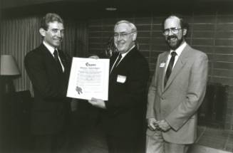 Jack Meredith (left) and Cedric Trueman (right) being presented with the Charter at the inaugural dinner in April of 1985.