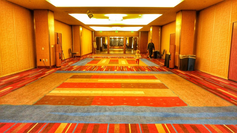 """Playing the """"lava game"""" in a quiet hallway of the conference hotel"""