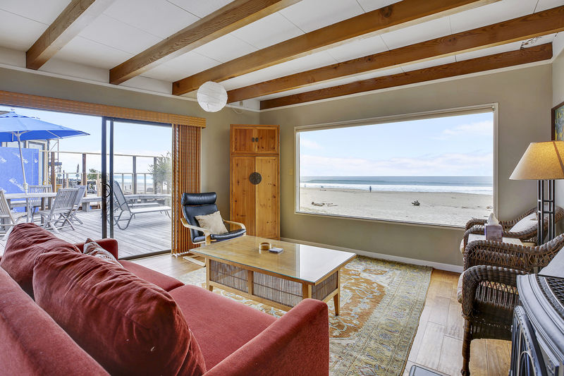 The Beach house - Efficient, comfortable, and it comes with a view that is hard to improve upon. Picture windows and sliding glass doors let the outside in. A gas fireplace takes the chill off winter nights. There's also a nice flat screen TV and quality programming.
