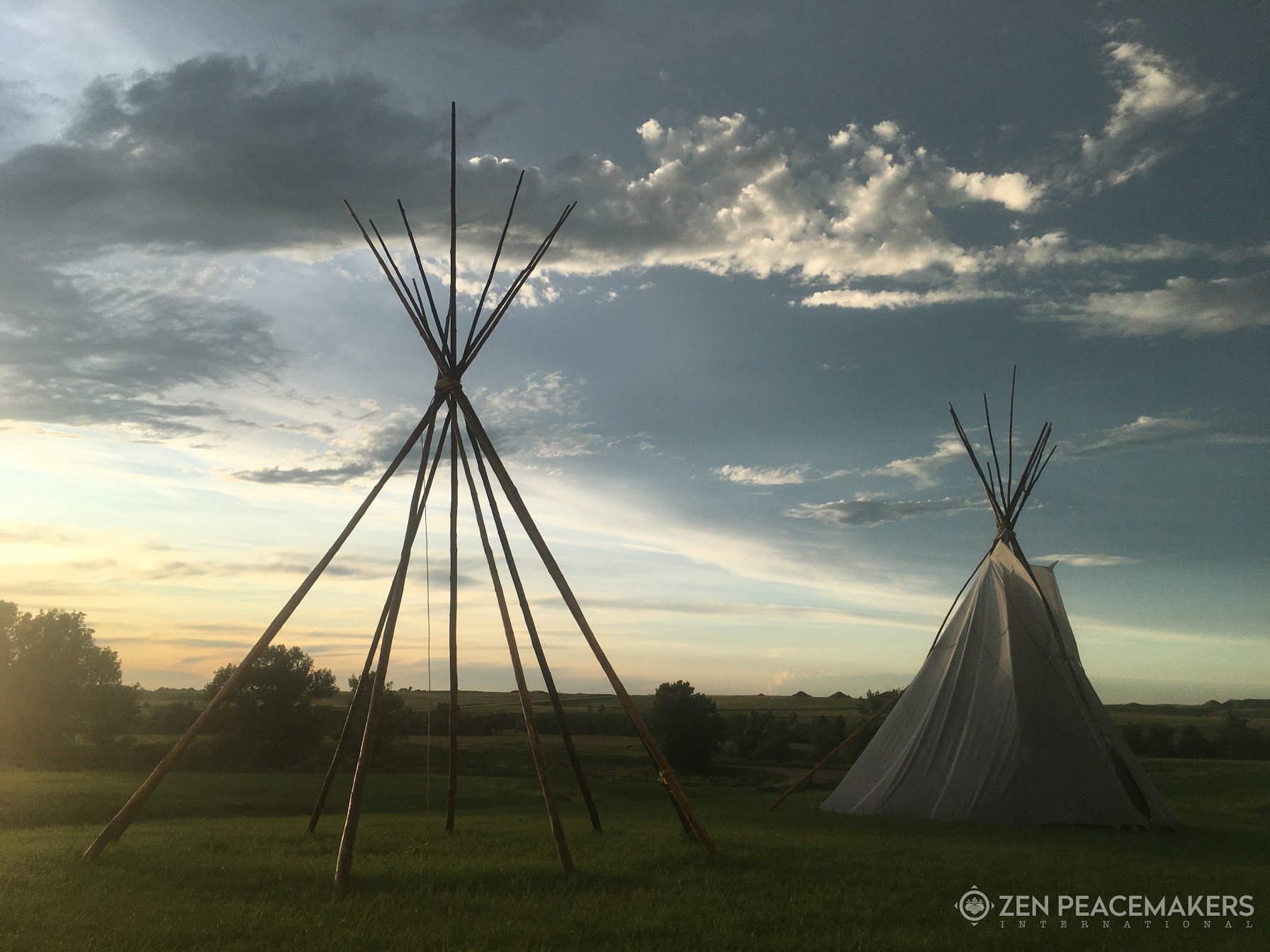 Lakota tipis at sacred site of Bear Butte, South Dakota - moments before a storm rolled in.