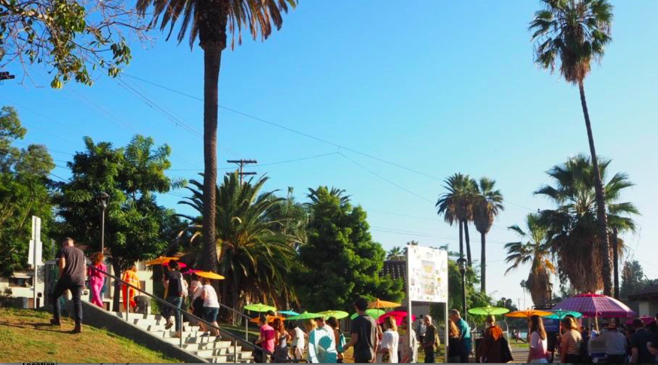 The performers and audience leave Echo Park Lake at the beginning of  Untitled: a procession on the borders of something that has already shifted , September 29, 2018.